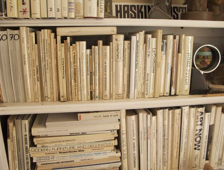 white spines books bookshelf