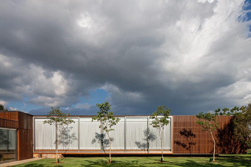 jacobsen arquitetura's MDT house is wrapped in warm teak skin