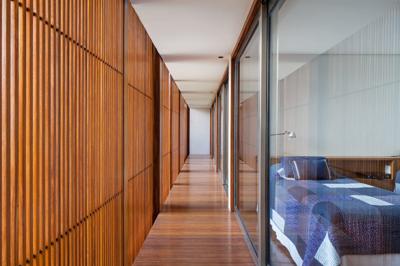 jacobsen arquitetura's MDT house is wrapped in warm teak skin