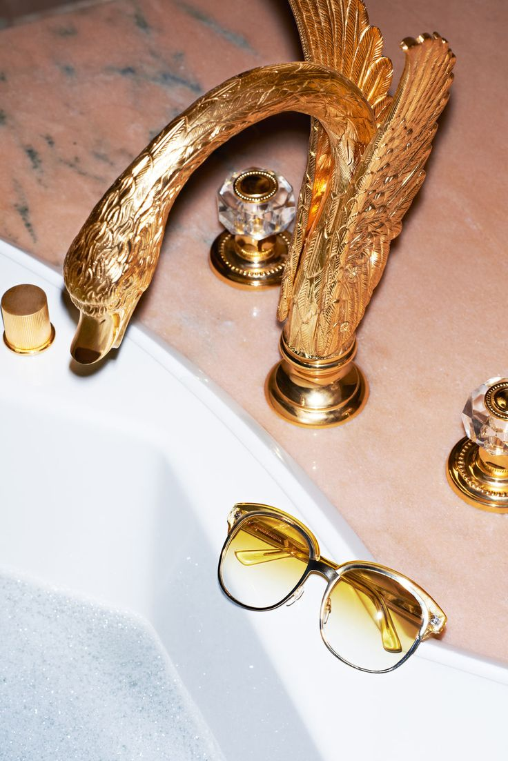 Golden-bathroom-faucet-inside-a-luxurious-private-room